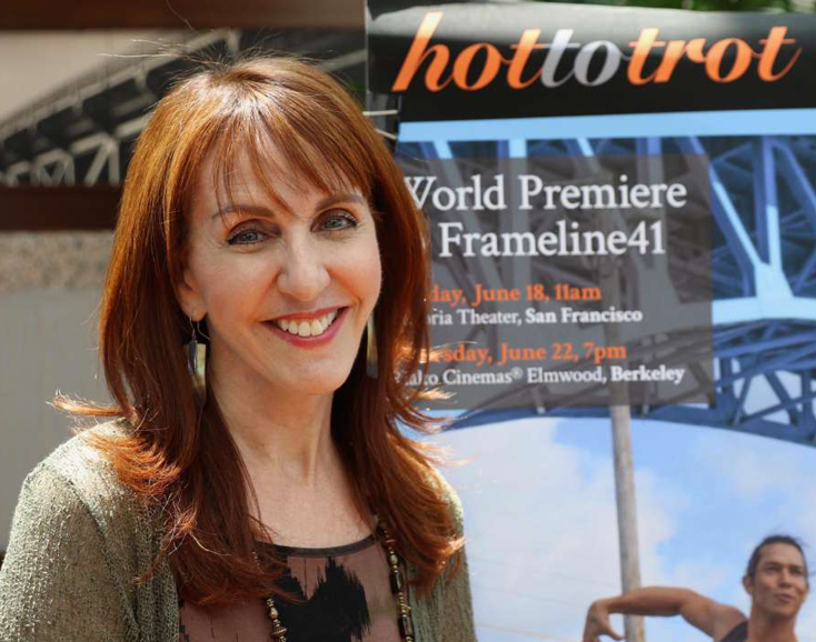 woman in front of hot to trot poster