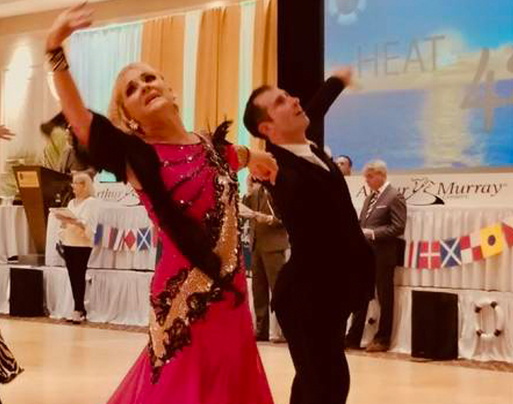 man and woman dancing in front of peers