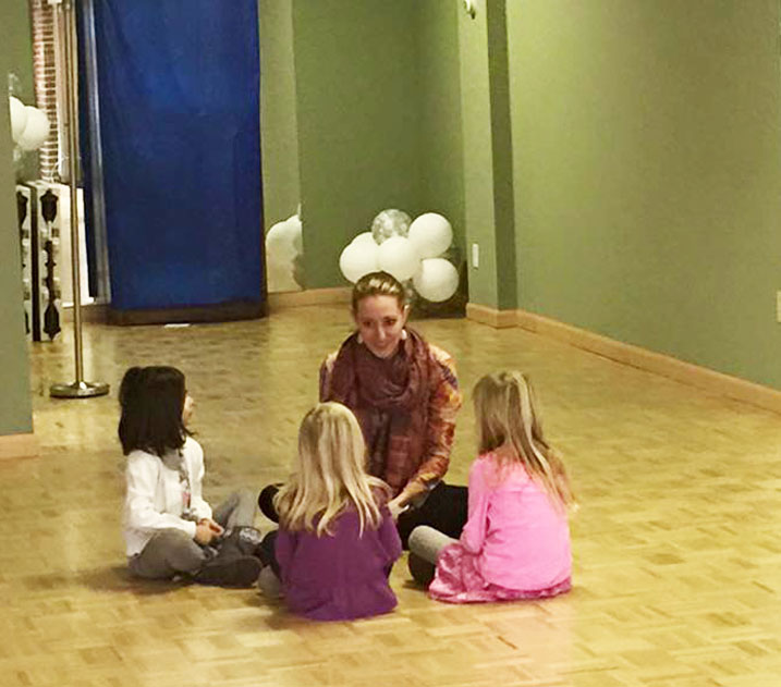 kids listening to dance tips from instructor